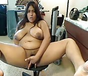 Plump Indian whore playing with her hairy pussy
