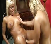 Two oiled blonde lesbians in pussy fisting magic