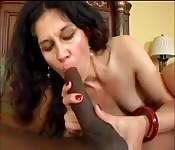 Dark-haired cougar sucking a massive black cock
