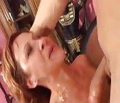 Redhead skank gets covered in white-hot jizz