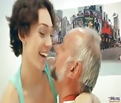 Busty girl seducing a mature man