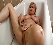 Busty MILF pleasuring herself with the shower head