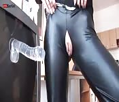 Crotchless pants and a dildo with a suction cup