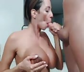Busty housewife sucking a cock