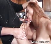 Mom sucking dick in the kitchen