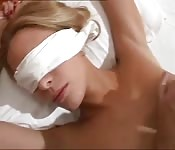 Blindfolded beauty wakes up to the cock