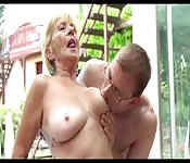 Mature MILFs gobbling younger cock