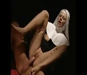 Naughty nun fucks delivery guy in her robes