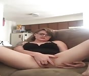 Cute amateur with glasses fingering herself